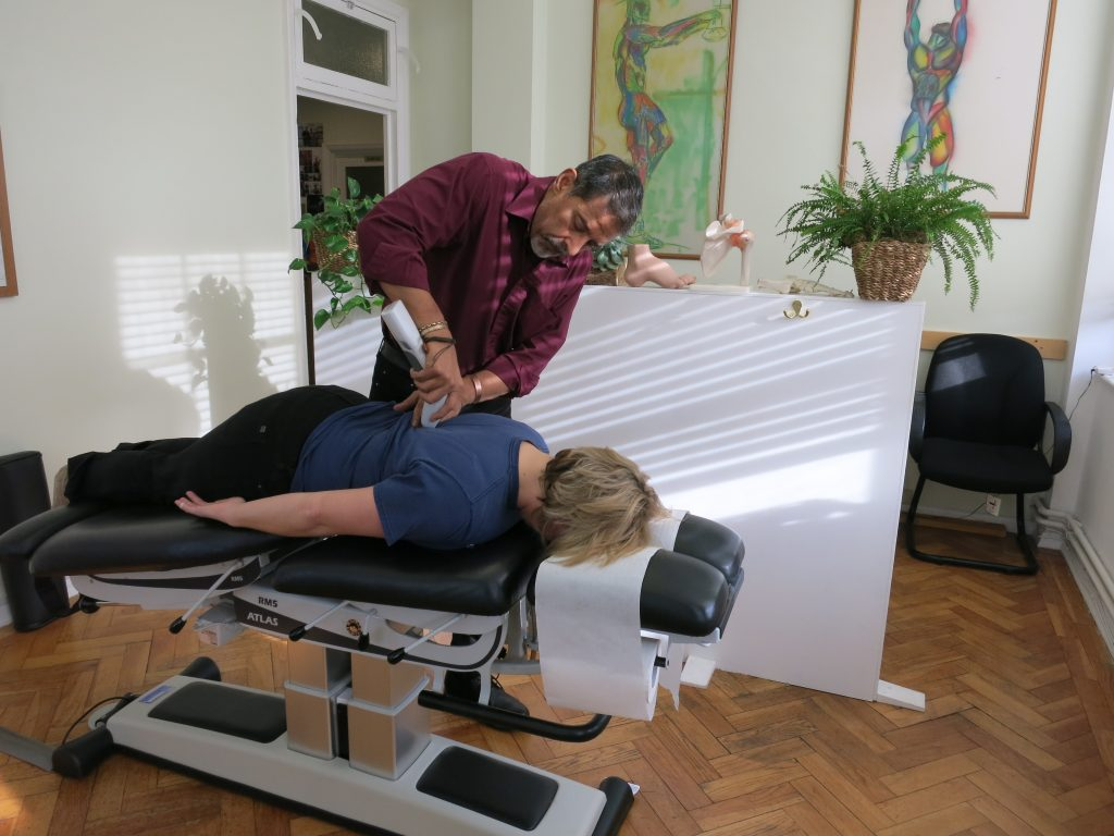 women receiving a chiropractic adjustment at the bedford chiropractic clinic