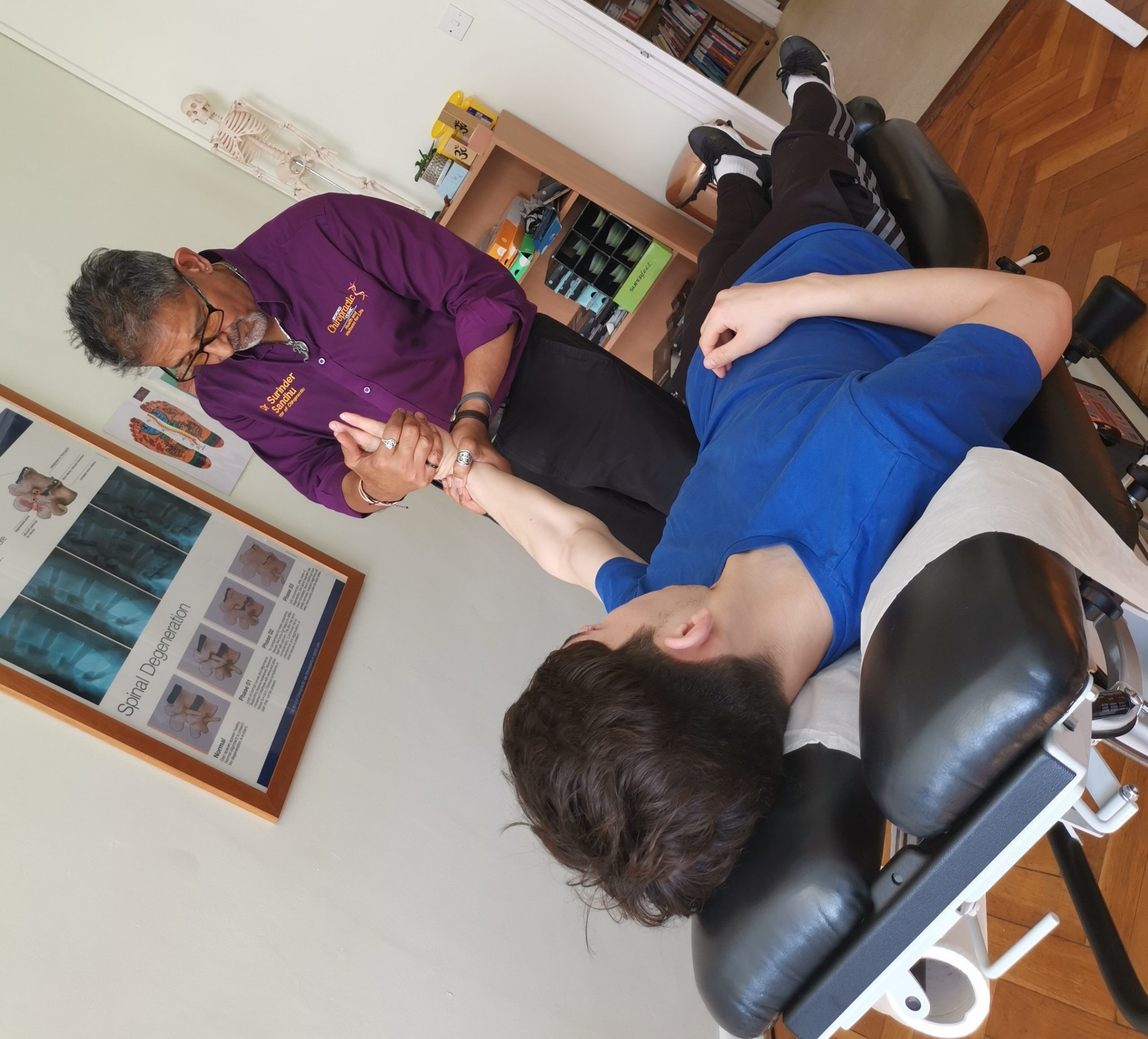 young man getting a chiropractic manipulation to his wrist