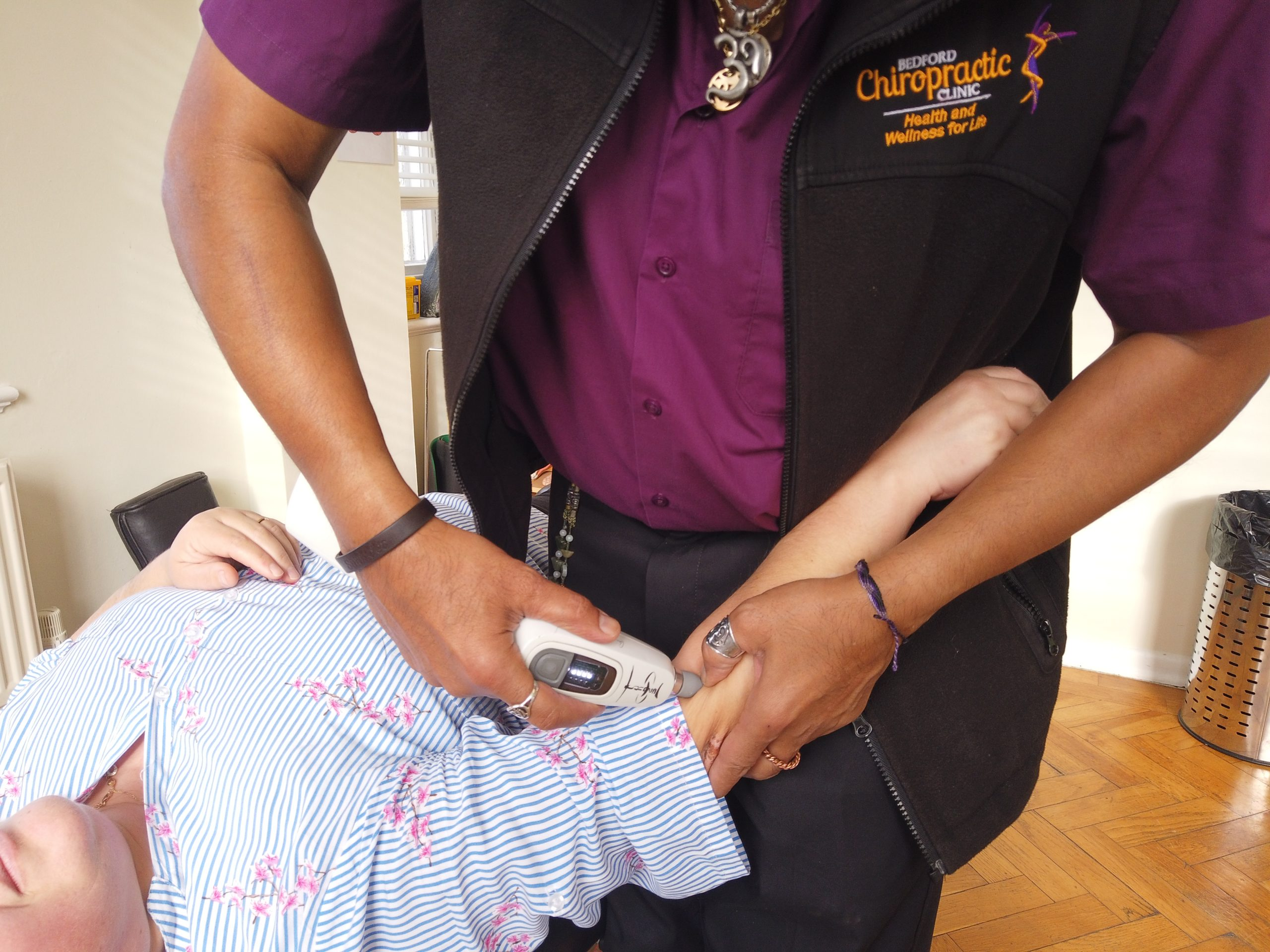 surinder sandhu at the bedford chiropractic clinic adjusting a misaligned elbow joint