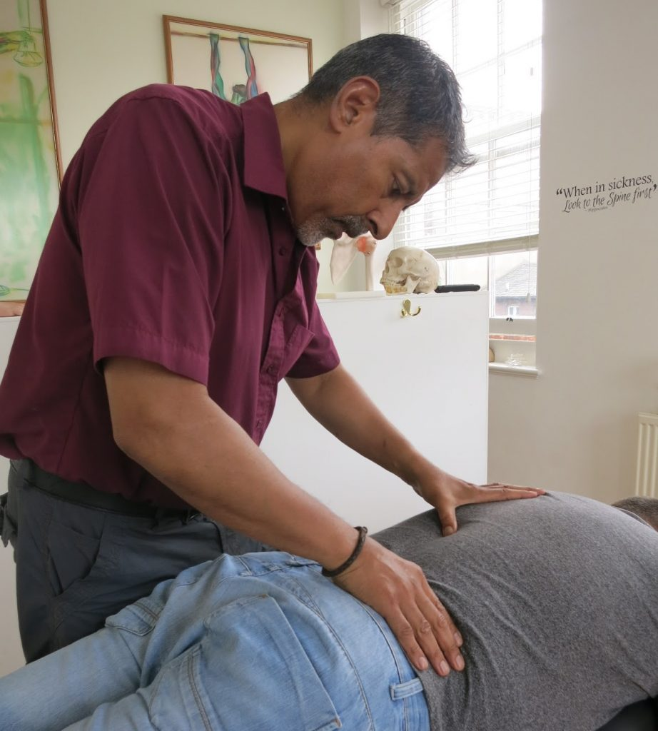 surinder sandhu at the bedford chiropractic clinic adjusting a patient's spine