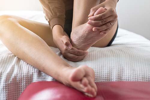 Close up of woman having a heel or foot sole pain,Female feeling exhausted and painful