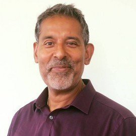 Surinder Sandhu, a headshot of the owner of the bedford chiropractic clinic & a chiropractor,