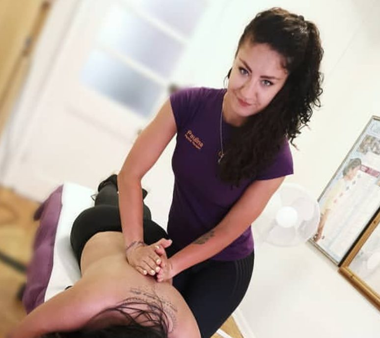 Paulina, the massage therapist at the Bedford Chiropractic Clinic giving a deep tissue massage at the bedford chiropractic clinic
