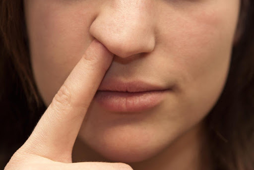 woman picking her nose, unhygenic